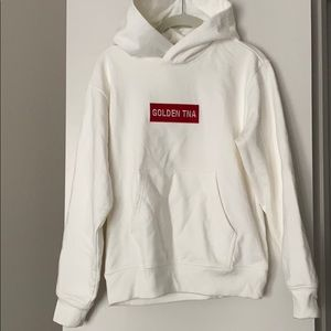 White hoodie with red logo.